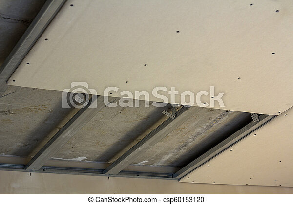 Close Up Detail Of Room Under Construction Suspended Ceiling From Drywall Fixed To Metal Frame With Screws Renovation Insulation Comfort