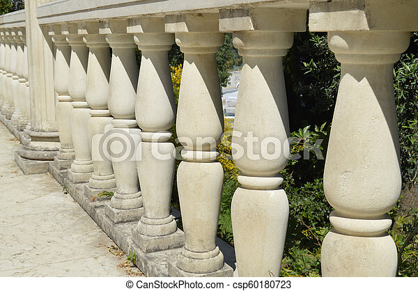 Close-up details of the balustrade, white marble columns, illuminated by the sun - csp60180723