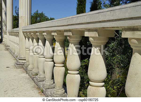 Close-up details of the balustrade, white marble columns, illuminated by the sun - csp60180725
