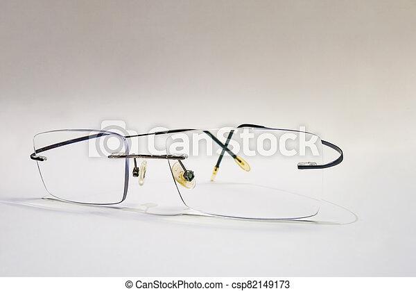 close up eyeglasses on white background - csp82149173