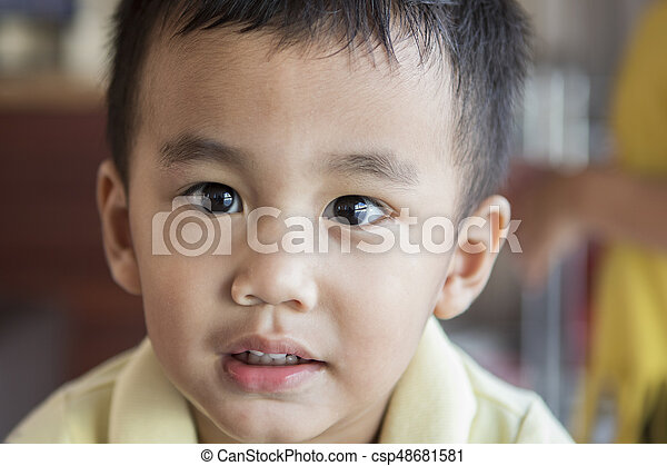close up eyes looking to camera and face of one year old asian toddle - csp48681581