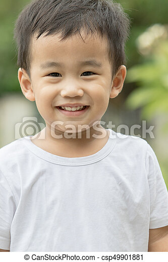 close up face of asian children looking to camera - csp49901881
