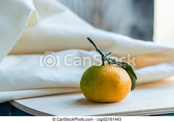 Close up fresh tangerine with leaf on white - csp52161443