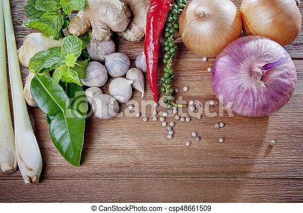 close up fresh thai spice herb on wood texture - csp48661509