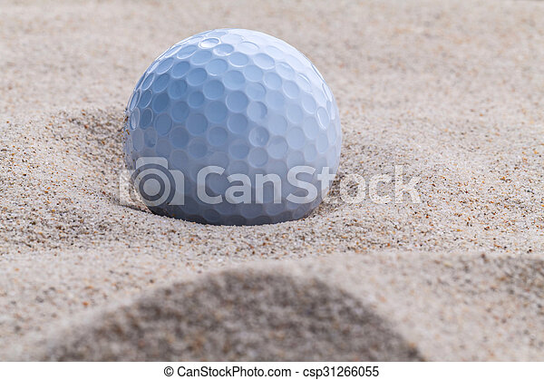 Close up golf ball in sand bunker shallow depth of field. - csp31266055