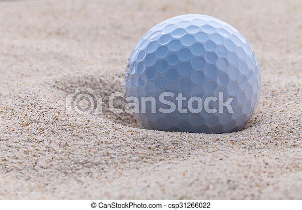 Close up golf ball in sand bunker shallow depth of field. - csp31266022