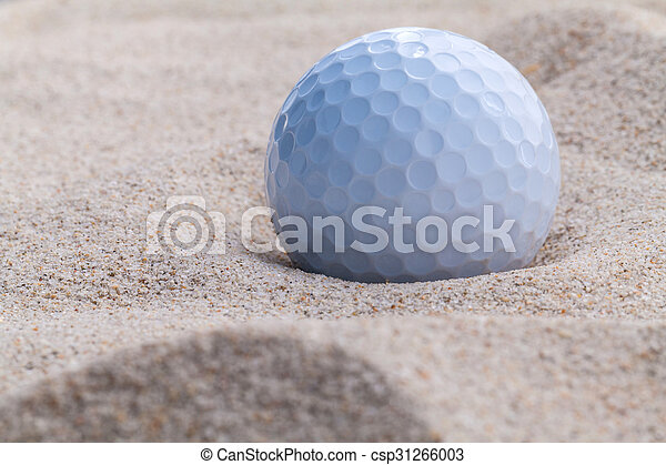 Close up golf ball in sand bunker shallow depth of field. - csp31266003