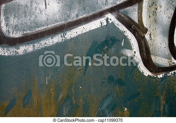 Close up graffiti on a green metal door - csp11099370