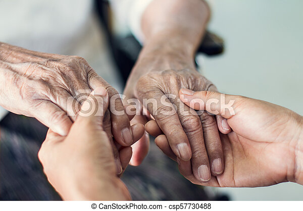 Close up hands of helping hands elderly home care. Mother and daughter. Mental health and elderly care concept - csp57730488