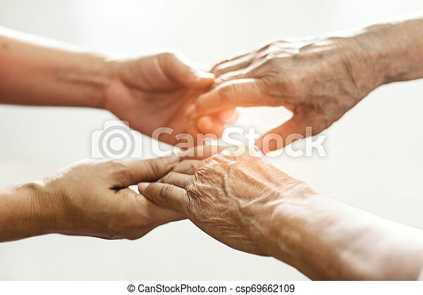 Close up hands of helping hands elderly home care. Mother and daughter. Mental health and elderly care concept - csp69662109
