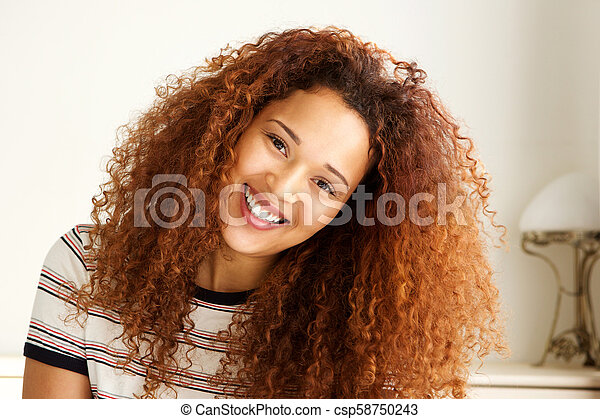 Close up happy young african american woman smiling - csp58750243