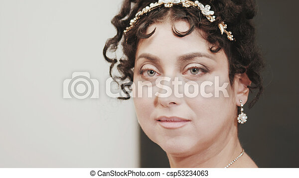 Close up historical portrait of middle-aged attractive woman in 18th century costume. Look of Marie Antoinette or bride in retro style. - csp53234063