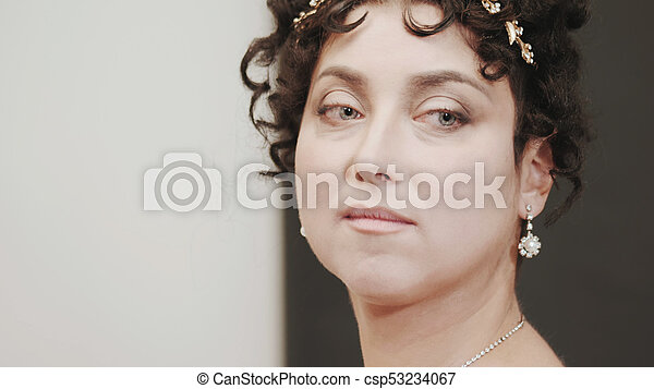 Close up historical portrait of middle-aged attractive woman in 18th century costume. Look of Marie Antoinette or bride in retro style. - csp53234067