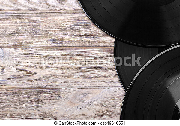 Close up image of old vinyl records over wooden background with copy space - csp49610551