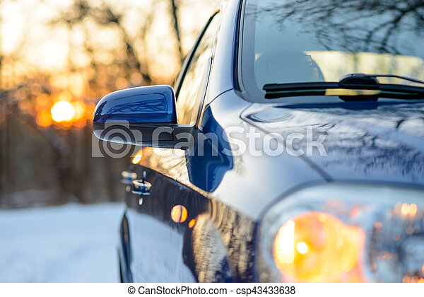 Close up Image of Side Rear-view Mirror on a Car in the Winter Landscape with Evening Sun - csp43433638