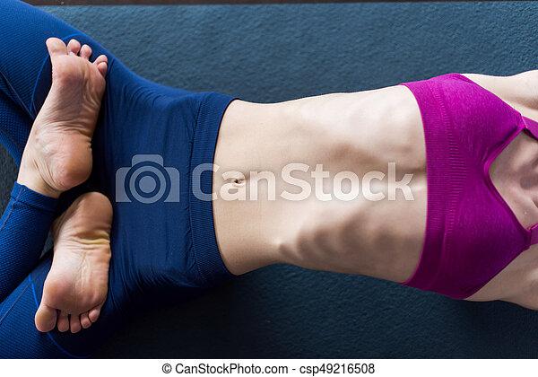 closeup image of slim female body in sports bra and