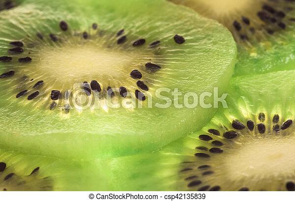 Close up kiwi slices background - csp42135839