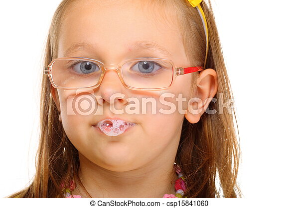 Close up little girl in glasses doing fun saliva bubbles - csp15841060