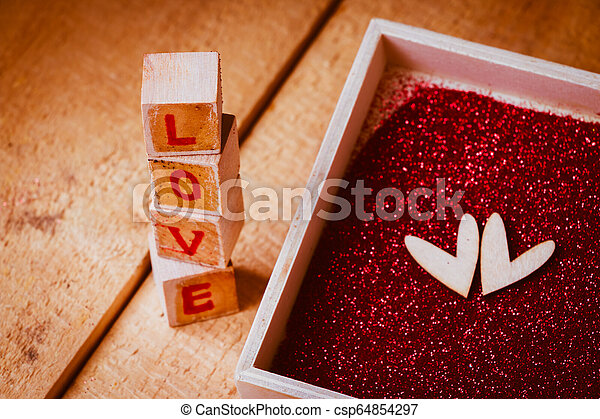 Close up LOVE text sign on wooden - csp64854297