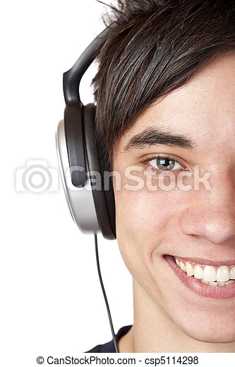 Close-up macro of a male teenager listening to music with headphone - csp5114298