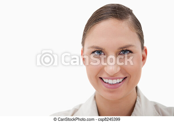 Close up of a businesswoman smiling at the camera - csp8245399