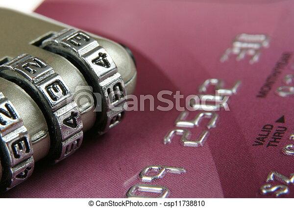 Close up of a credit card and padlock- security concept - csp11738810