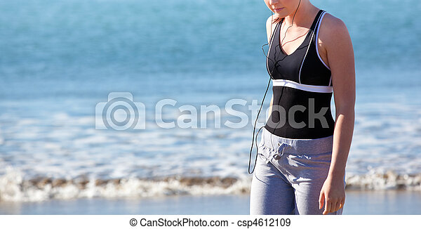 Close up of a female on the beach - csp4612109