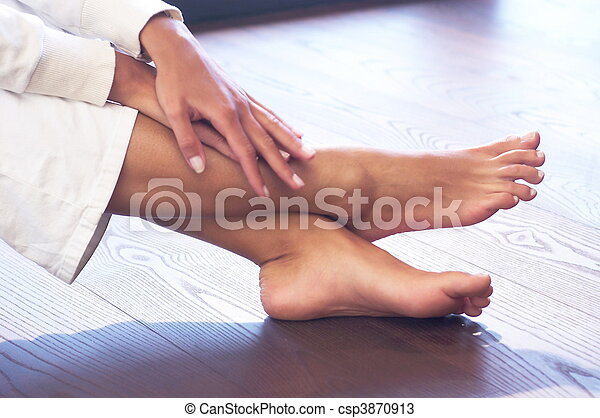close-up of a female person´s hands and feet; wooden floor; white leisure wear; frontside - csp3870913