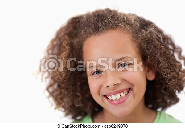 Close up of a girl smiling at the camera - csp8249370