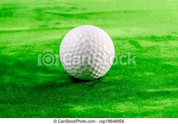 Close up of a golf ball on the green - csp18648956