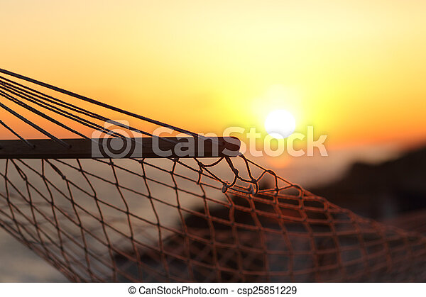 Close up of a hammock on the beach at sunset - csp25851229