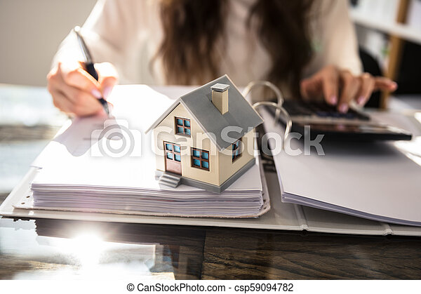 Close-up Of A House Model On Glass Desk - csp59094782