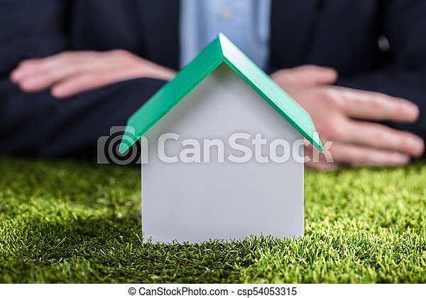 Close-up Of A House Model On Green Grass - csp54053315
