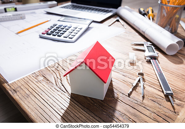 Close-up Of A House Model On Wooden Desk - csp54454379