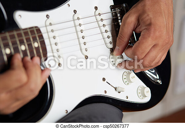 Close up of a lefty electric guitar being played - csp50267377