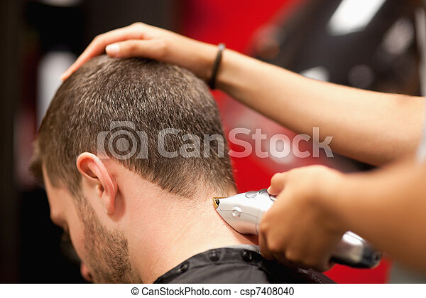 Close up of a male student having a haircut - csp7408040