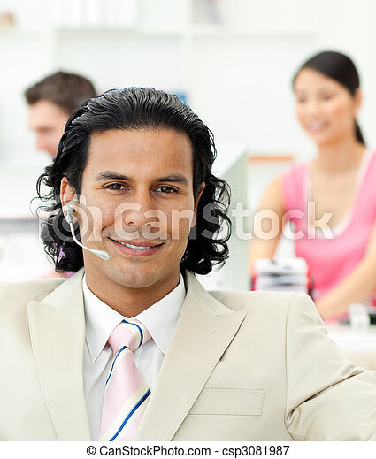 Close-up of a manager talking on headset  - csp3081987
