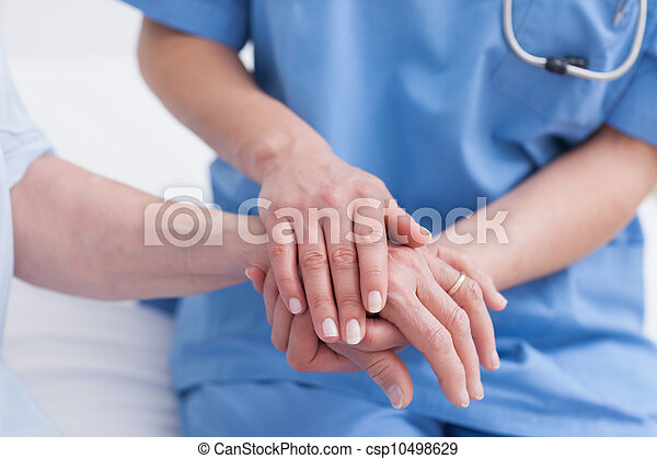 Close up of a nurse touching hand of a patient - csp10498629