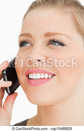 Close up of a pretty woman calling - csp10488829