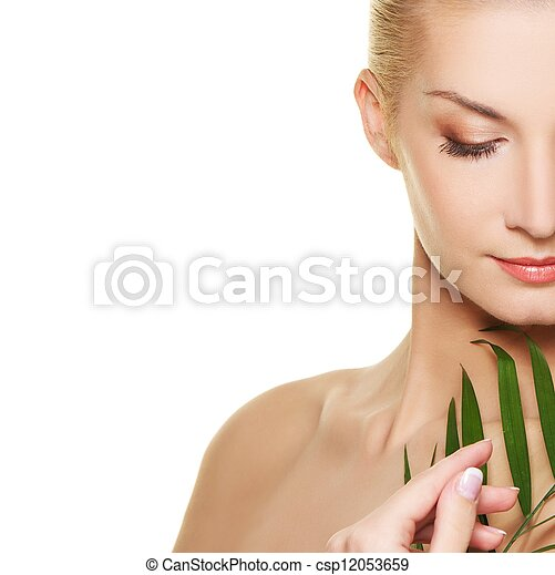 Close-up of a woman face with green plant - csp12053659