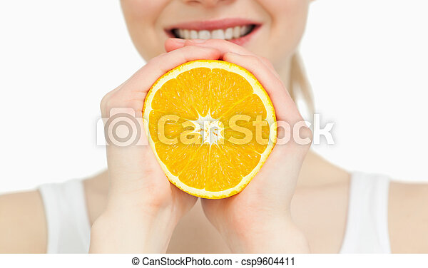 Close up of a woman holding an orange - csp9604411