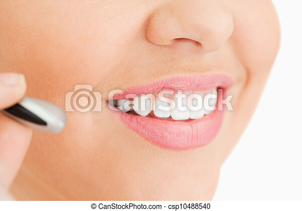 Close-up of a woman working in a call center - csp10488540