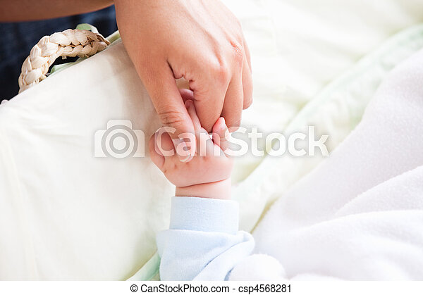Close-up of a young mother holding her baby's hand - csp4568281