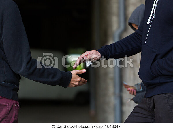 close up of addict buying dose from drug dealer - csp41843047
