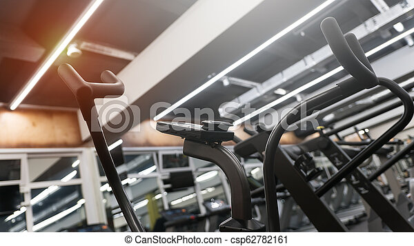 Close-up of an elliptical trainer in a gym club - csp62782161