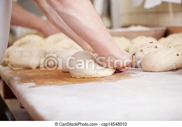 Close-up of baker kneading - csp14548010