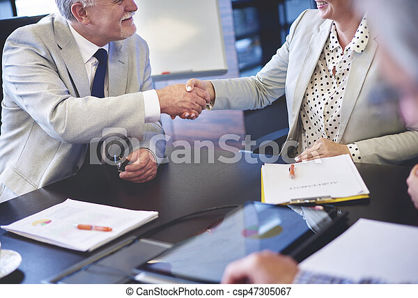Close up of business couple shaking hands - csp47305067