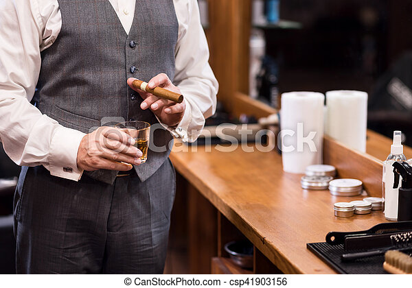 Close up of business man with glass and cigar - csp41903156