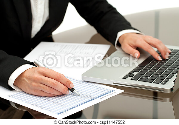 Close up of business woman's hands working. - csp11147552