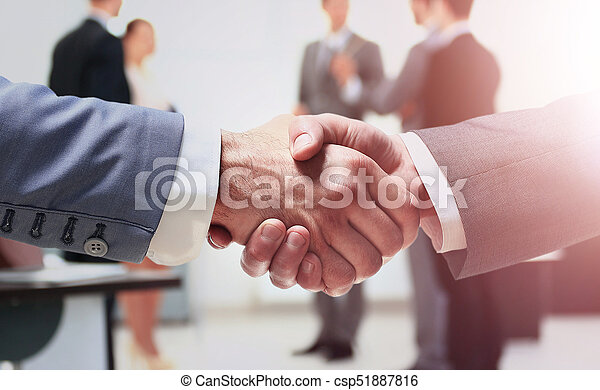 Close up of businessmen shaking hands - csp51887816